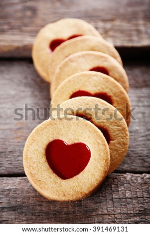 Group of love cookies on wooden background, closeup - stock photo