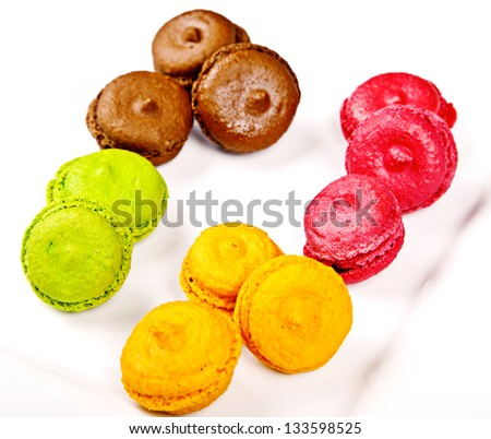 Group of macaroons different colours on white plate - stock photo