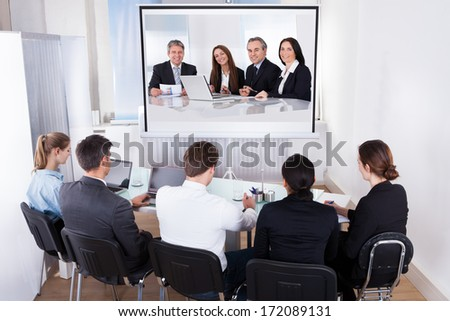 Group Of Male And Female Businesspeople At Video Conference - stock photo