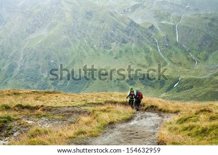 Group of man hiking in the Hohe Tauern mountains in Austria
