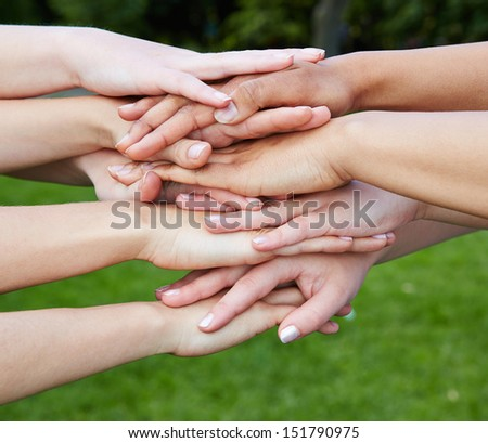 Group of many hands as team motivation concept in nature - stock photo
