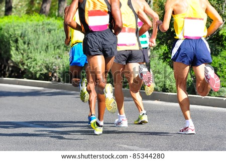 Group of marathon racers running - stock photo