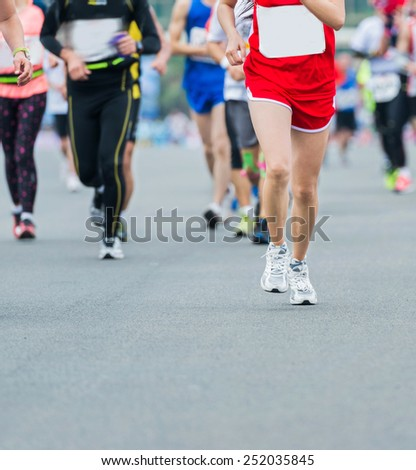 Group of marathon runners compete in the race - stock photo