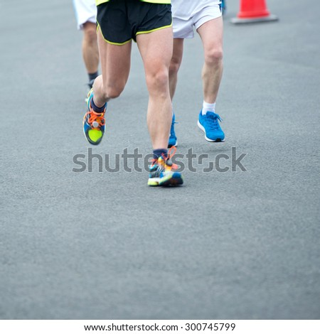 group of marathon runners compete in the race, blurred motion