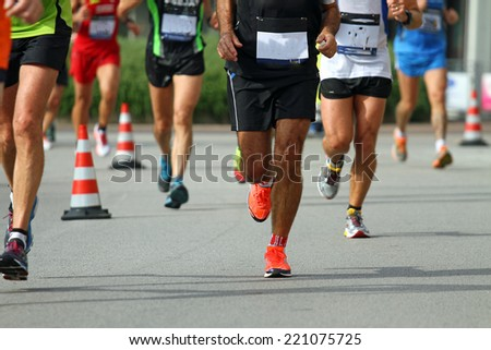 Group of marchers during the sporting competition on the road - stock photo