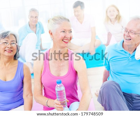 Group of Mature Diverse People Smiling While Exercising - stock photo