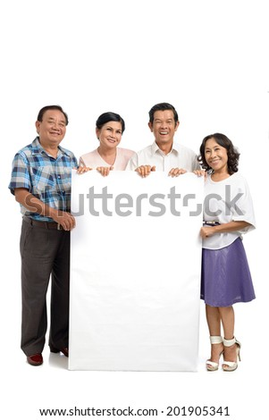 Group of mature people holding a blank board - stock photo