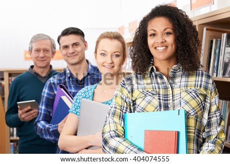 Group Of Mature Students Studying In Library - stock photo