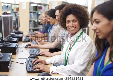 Group Of Mature Students Working At Computers - stock photo