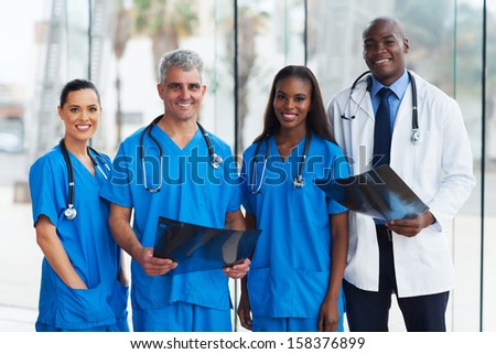 group of medical doctors in office with patient's x-ray - stock photo