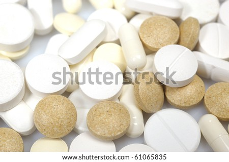 Group of medical pills and vitamins. can be used as background - stock photo