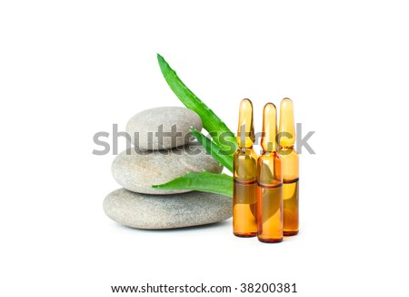 Group of medicine ampules, stones and aloe. Isolated on white background - stock photo