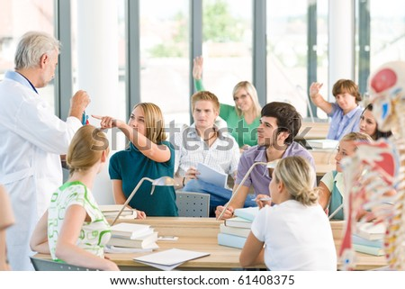 Group of medicine students with professor having anatomy class - stock photo