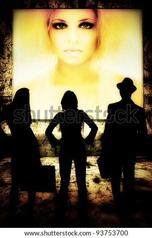 Group of men and woman viewing multimedia screen. - stock photo