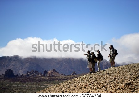 Group of men and women hiking