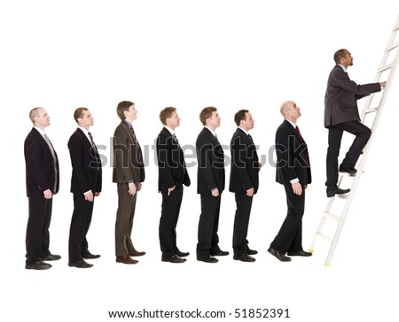 Group of men standing in a line, waiting to climb a ladder - stock photo