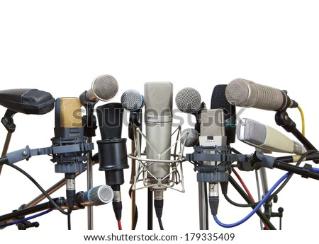 Group of microphones prepared for conference meeting - isolated on white.  - stock photo
