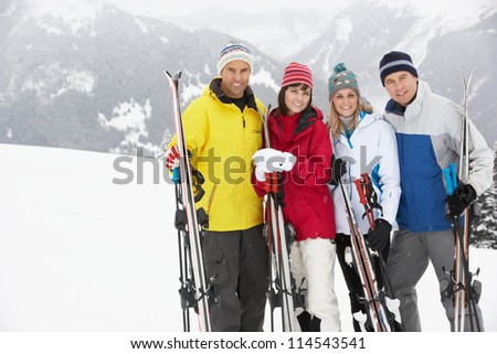 Group Of Middle Aged Couples On Ski Holiday In Mountains - stock photo