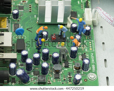 group of mini mechanical are working on mainboard computer - can use to display or montage on product or concept repair electronic ship - stock photo