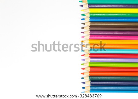 Group of mixed colours wooden pencils on white background - stock photo