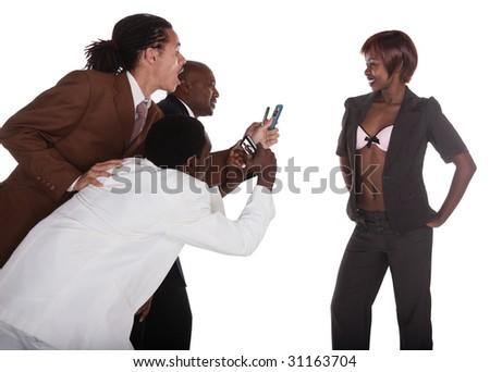 group of mixed race businessman having fun at a phonoshoot, phone shooting - stock photo