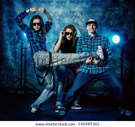 Group of modern dancers over grunge background. Urban, disco style. - stock photo