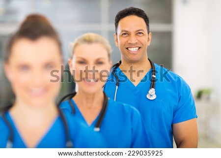 group of modern medical professionals in hospital - stock photo