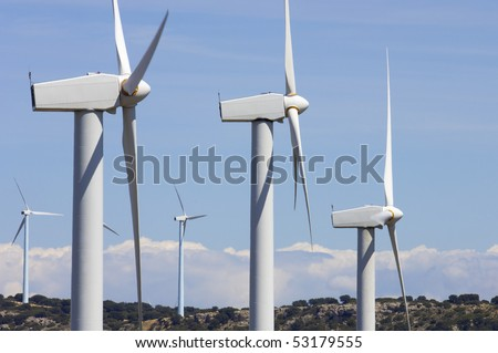 group of modern windmills and hills in the horizon - stock photo