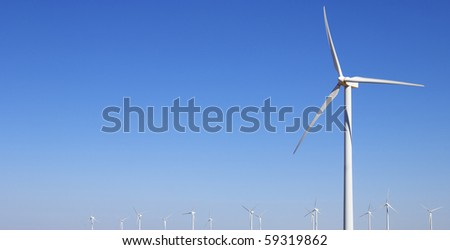 group of modern windmills for electric power production - stock photo