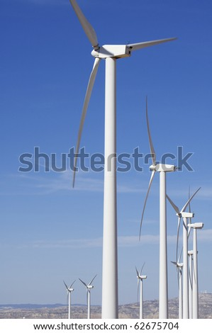 group of modern windmills for electric power production
