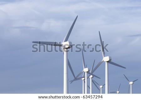 group of modern windmills in monochromatic blue tone - stock photo