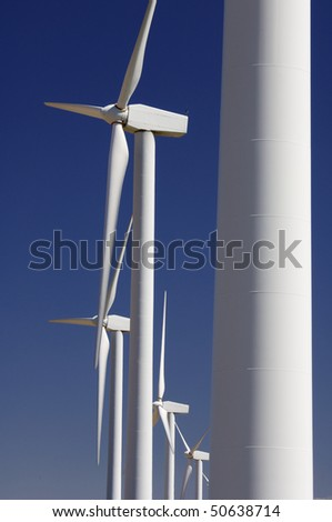 group of modern windmills with a clear blue sky