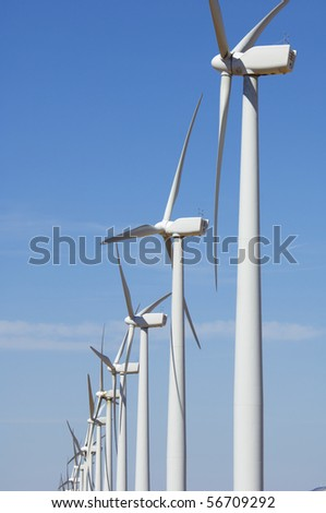 group of modern windmills with blue sky - stock photo
