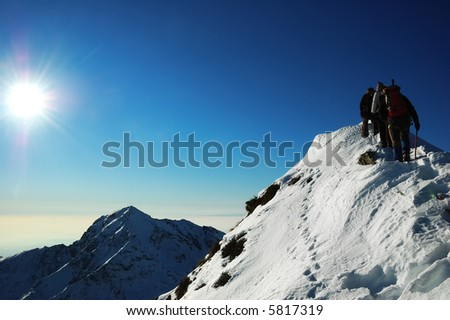 Group of mountaineers climbing a mountain Ridge, west Alps - stock photo