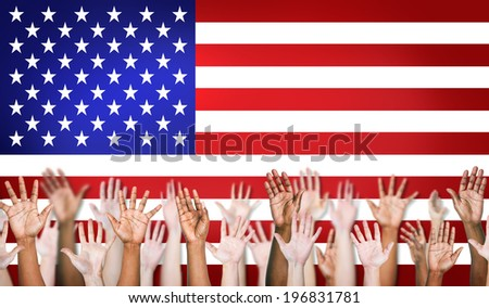Group Of Multi-Ethnic Arms Outstretched With North American Flag As A Background.