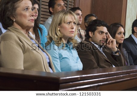 Group of multi ethnic business people sitting at court house - stock photo