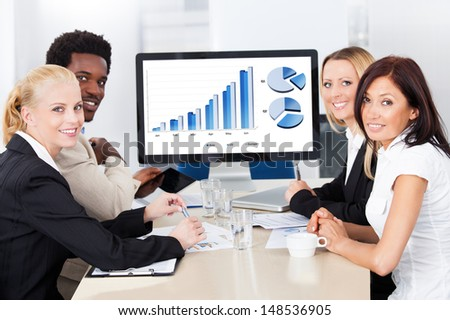 Group Of Multi Ethnic Businesspeople Discussing Together In Office