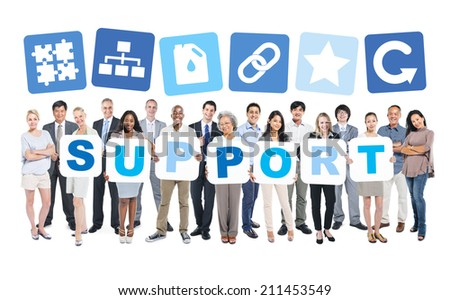 Group Of Multi-Ethnic Group Of Business People Holding Placards Forming Support And Related Symbols Above - stock photo