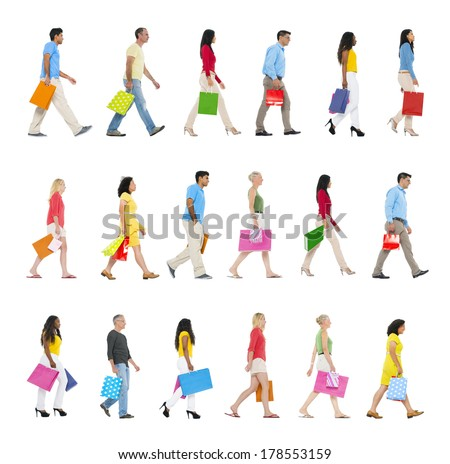 Group of Multi-ethnic People Walking Forward with Shopping Bags - stock photo