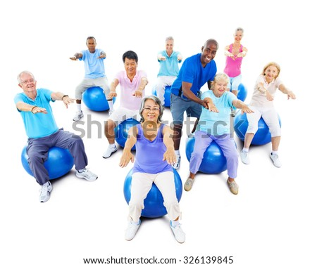 Group Of Multi-Ethnic Senior Adults Exercising Yoga Concept