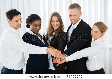 Group Of Multi-racial Businesspeople Together Stacking Hands Over Each Other - stock photo