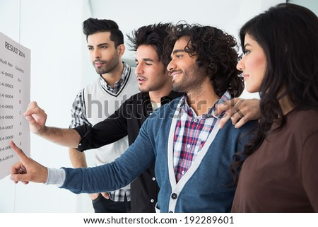group of multi racial students checking the results