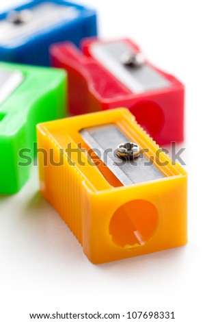 Group of multicolor pencil sharpeners, close-up shot, isolated on white background - stock photo