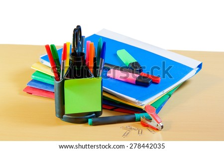 Group of multicolored office folders, glasses and office supplies on table - stock photo