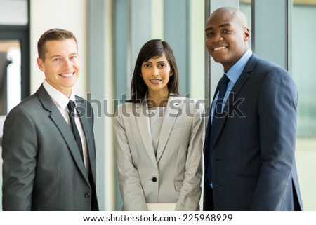 group of multicultural businesspeople standing in modern office - stock photo