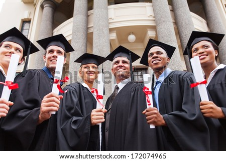 group of multicultural graduates standing outdoors with dean - stock photo