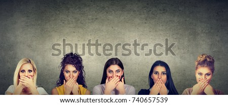 Group of multicultural women covering their mouth scared to speak out about abuse and domestic violence
