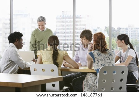 Group of multiethnic business colleagues at office meeting - stock photo