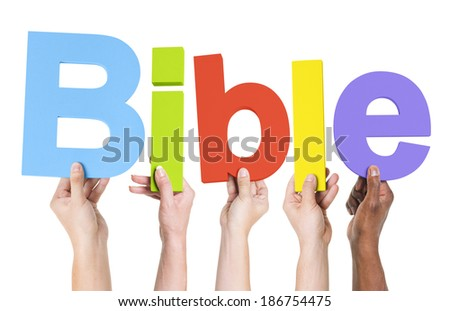 Group of Multiethnic Hands Holding Bible - stock photo