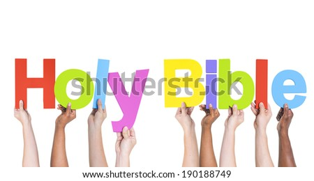 Group of Multiethnic Hands Holding Holy Bible - stock photo